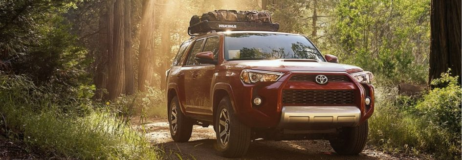 The 2018 Toyota 4Runner driving through the woods in a blog post about Toyota cars for sale in Sanford, NC.