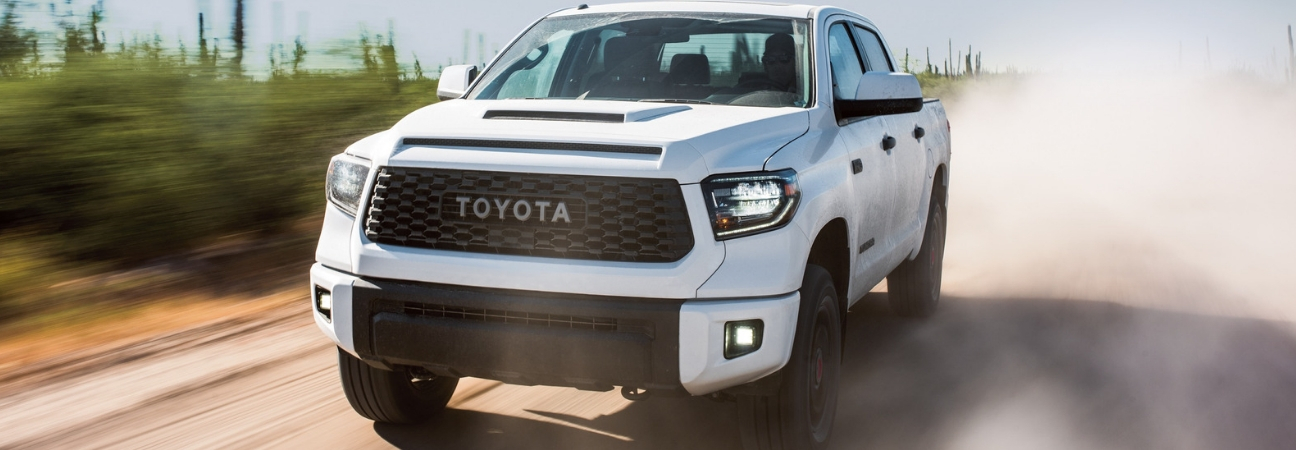 2019 Toyota Tundra driving down dusty road