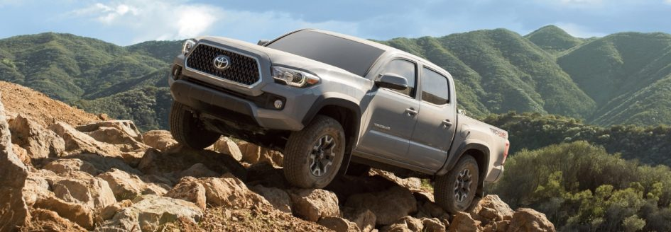 A 2019 Toyota Tacoma parked on a rocky hill