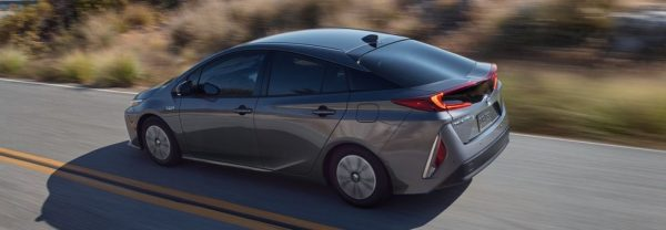 2020 toyota prius driving through the country side
